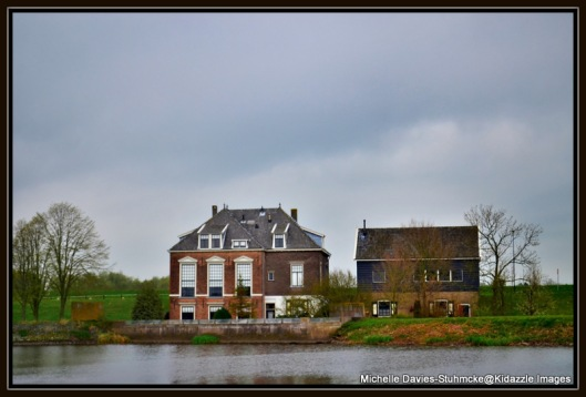 Beautiful old home across the river from the windmills
