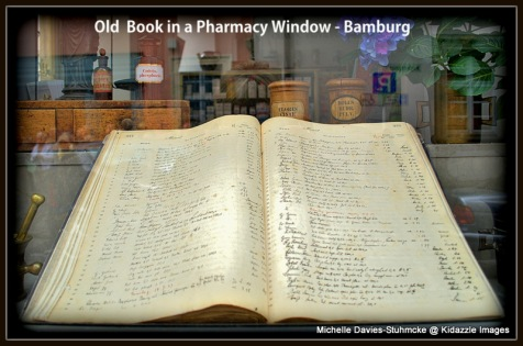 Very old book in a pharmacy window, Bamberg.
