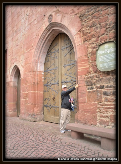 Beautiful old doorway with flood levels on wall beside, in Miltenberg,Germany