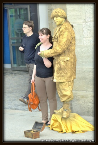 Mozart with a tourist, Rergensburg, Germany.